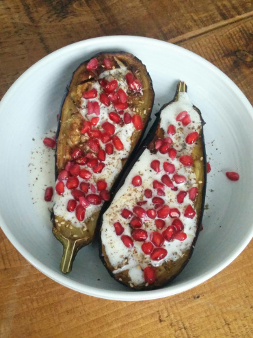 Ottolenghi's aubergines with buttermilk sauce and pomegranite seeds