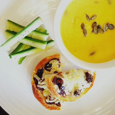 Homemade pumpkin soup with cheese and pickle muffins.