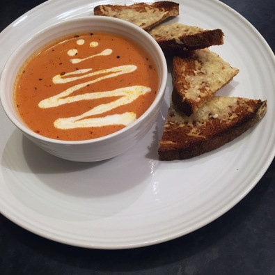 Homemade creamy tomato soup with parmesan toasts.