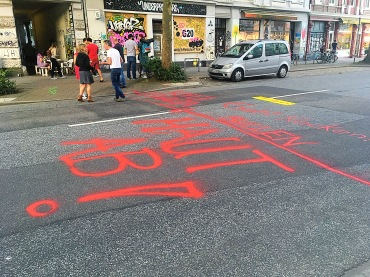 Graffiti on the roads warns police that they are not welcome.