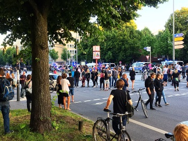 Crowds gather to watch as self-proclaimed anarchists try to provoke police.