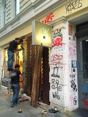 Shops that became targets for ant-capitalist rioters boarded up windows and closed for the weekend.